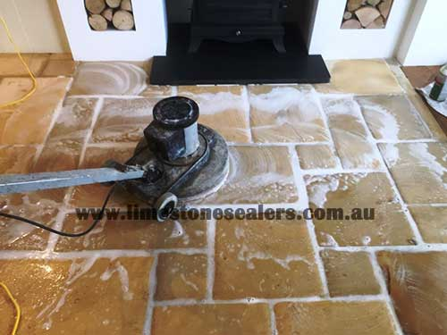 Hobart cleaning and sealing limestone in floor of kitchen