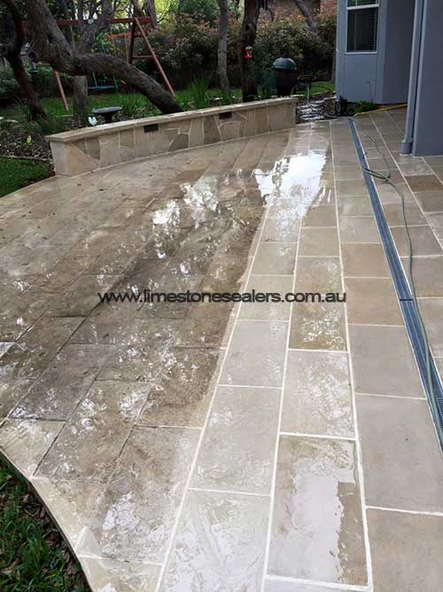 Wagga Wagga limestone patio tiles before and after cleaning