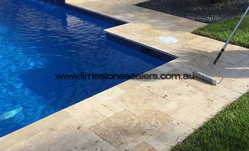 outdoor limestonetile-floor-around-pool
